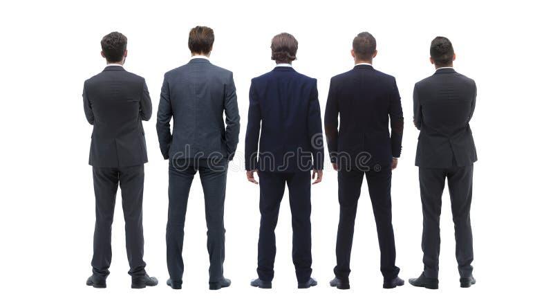 Задняя группа в составе взгляда бизнесмены изолированная белизна вид сзади Изолировано над белой предпосылкой стоковые изображения rf