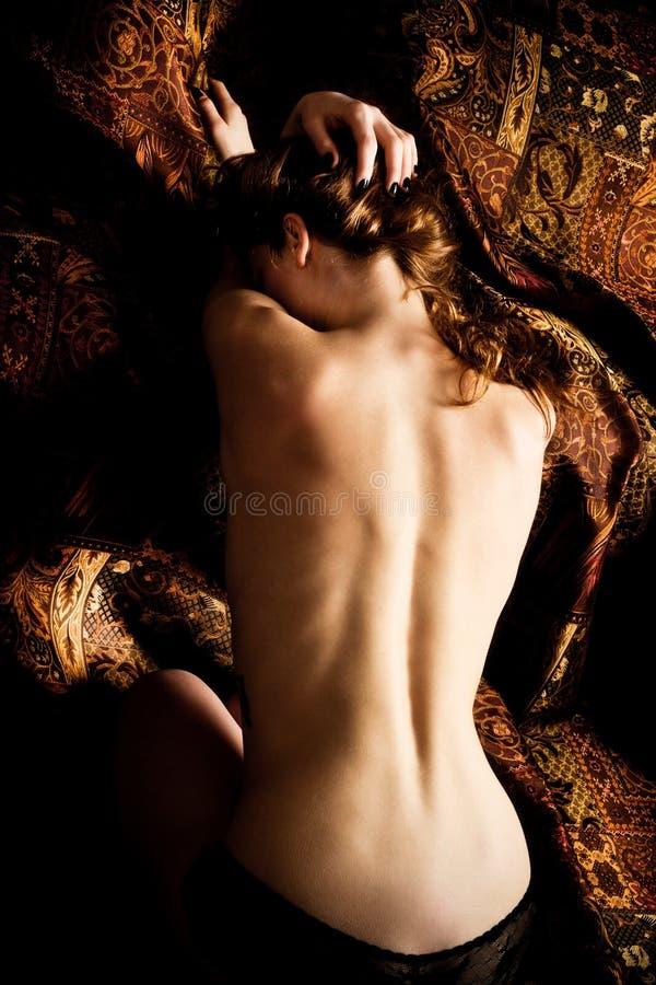задняя женщина стоковое фото
