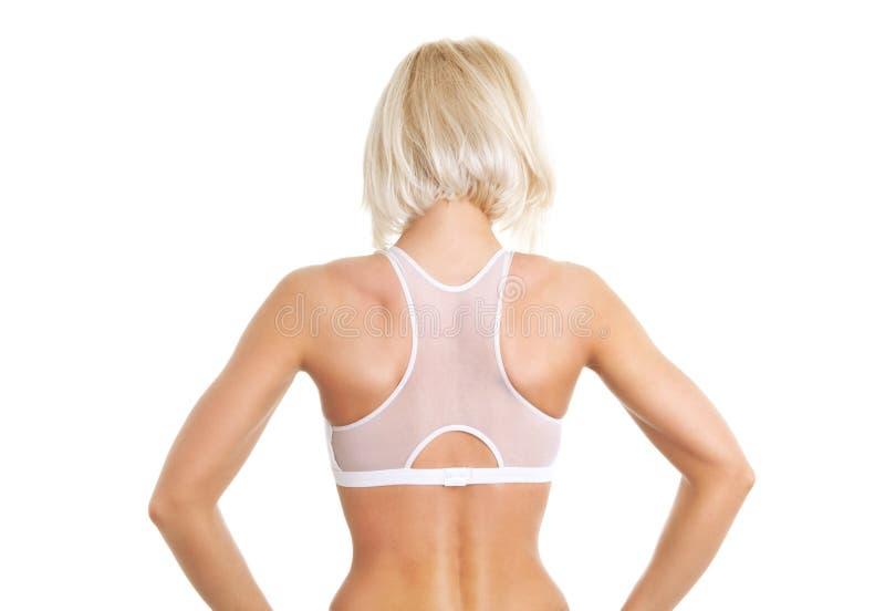 Задняя часть женщины над белой предпосылкой стоковые изображения rf