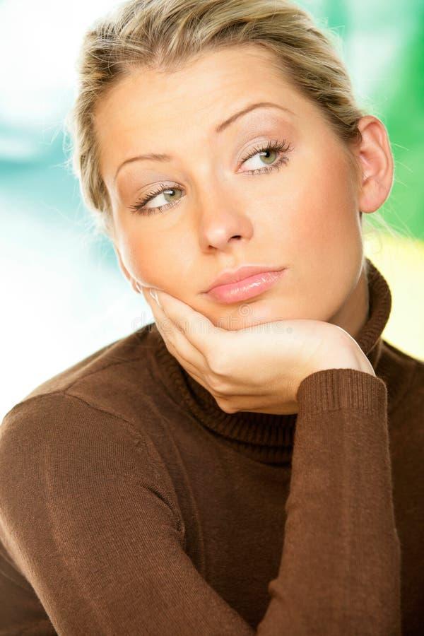 задумчивая женщина стоковая фотография rf