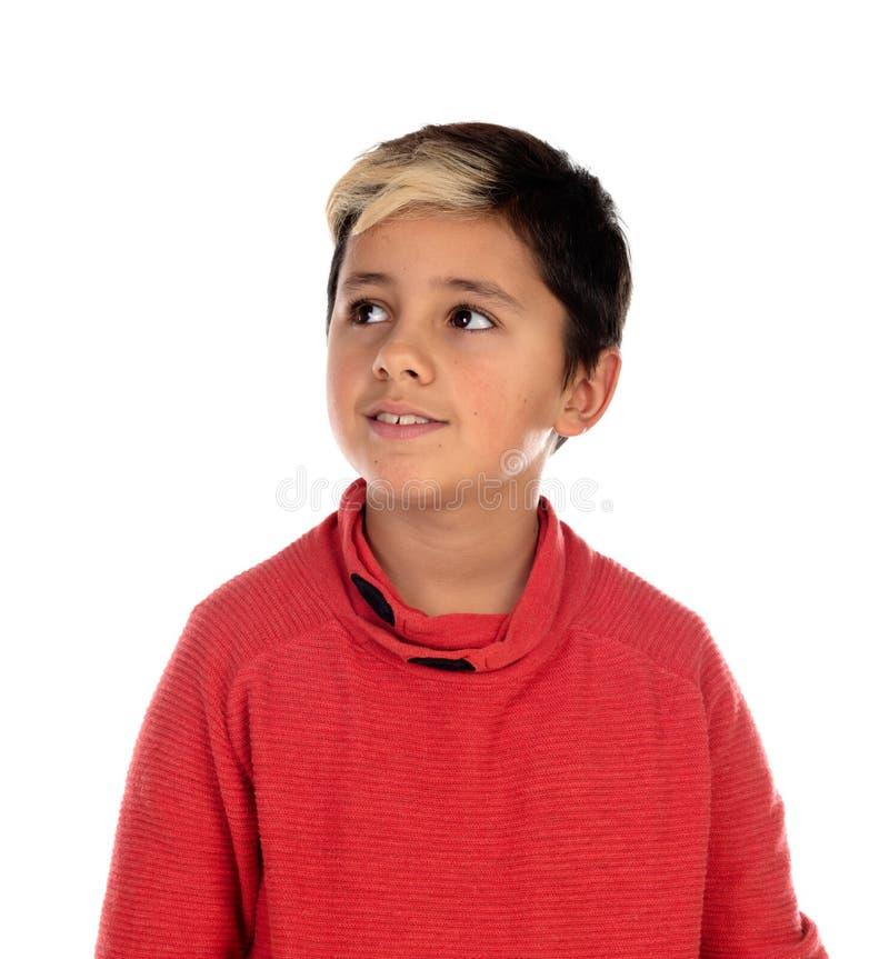 Задумчивый ребенок с 10 летами и фитиль на его волосах стоковые фотографии rf