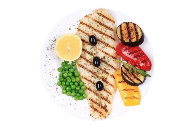 Зажаренное филе рыб с овощами стоковая фотография rf