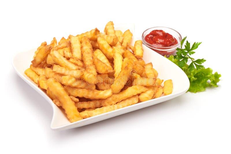 Зажаренный картофель фри картошки с кетчуп, изолированным на белой предпосылке стоковое фото