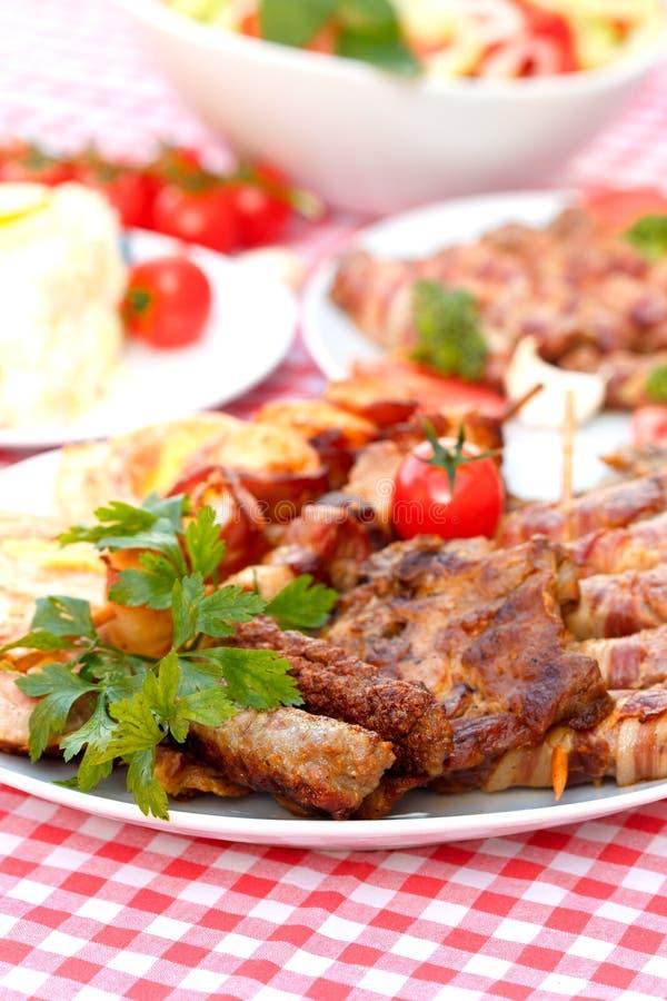 зажженная плита мяса стоковая фотография