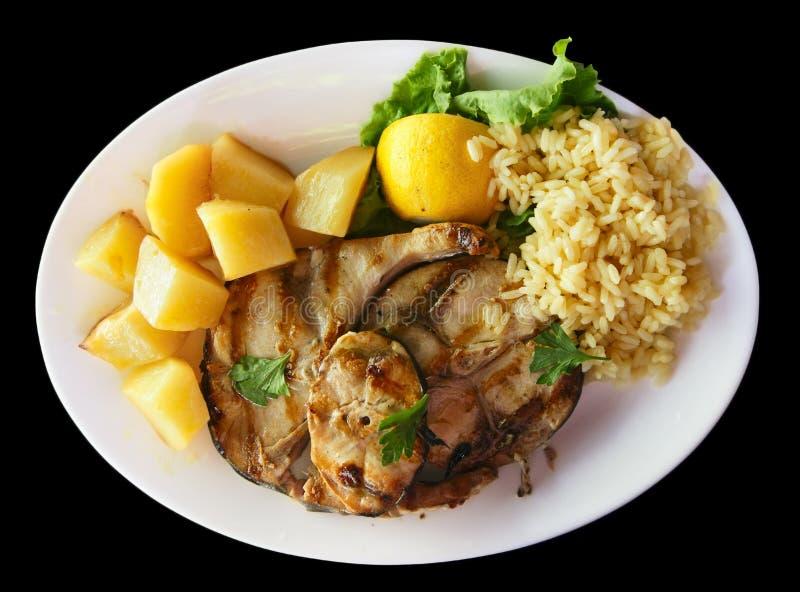 Зажженное mackarel с рисом и картошками стоковые фото