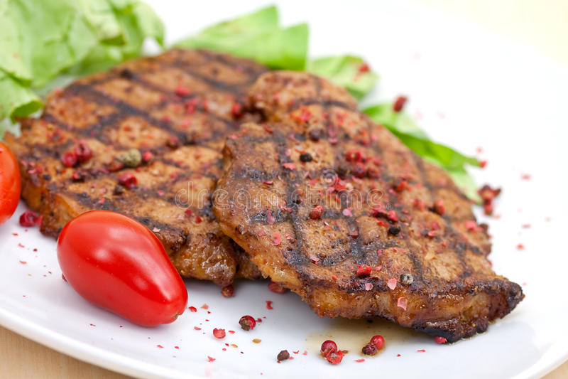 зажженный стейк салата свинины стоковая фотография rf