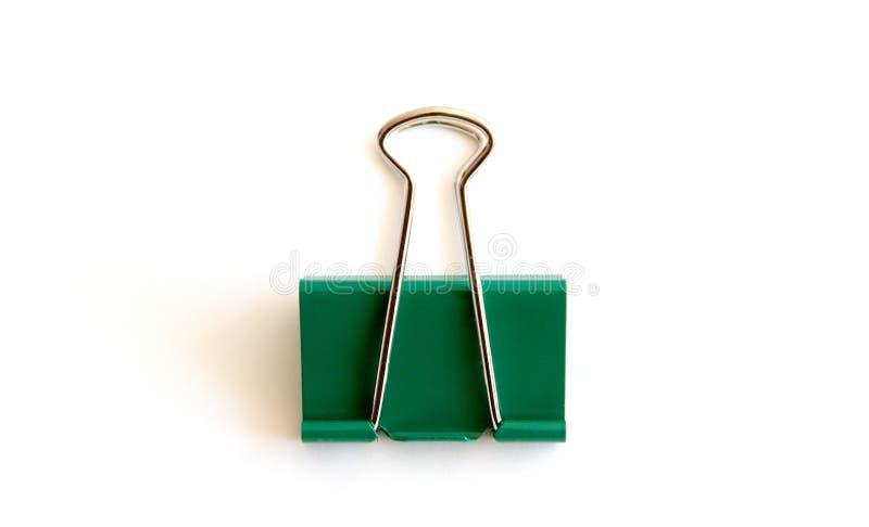 Зажим зеленой книги изолированный на белой предпосылке - изображении стоковое фото