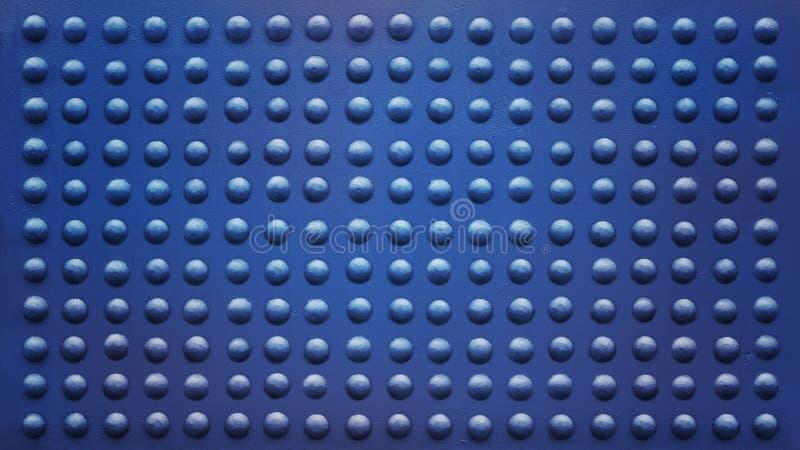 Заклепанная синь плиты вполне стоковое фото