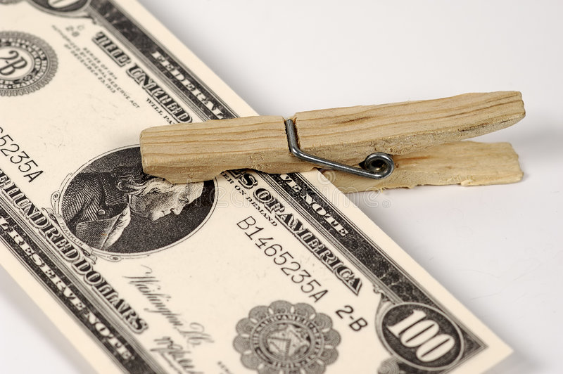 закрепите деньги стоковая фотография