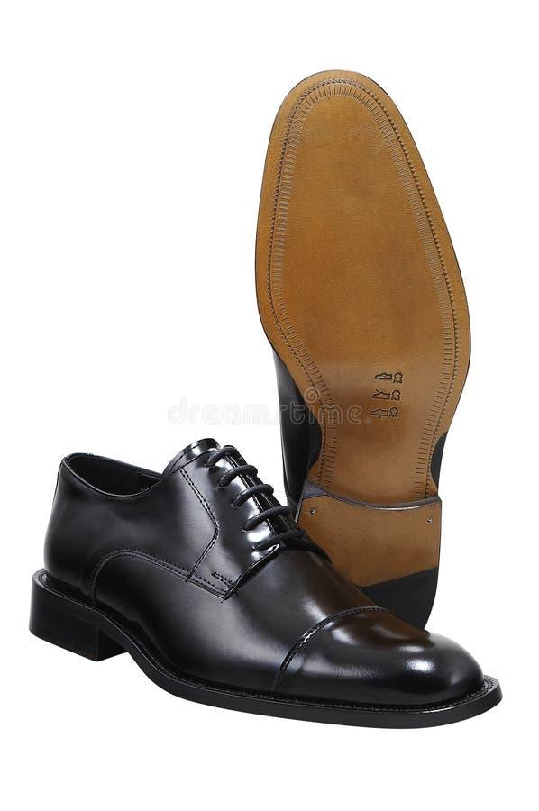 закрепляя изолированные ботинки путя стоковые изображения rf