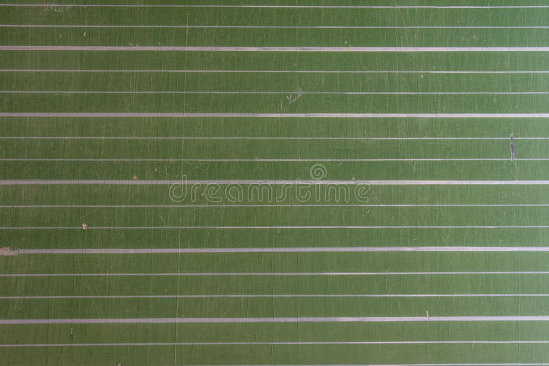 Закройте вверх зеленого цвета, striped доски стоковое фото rf