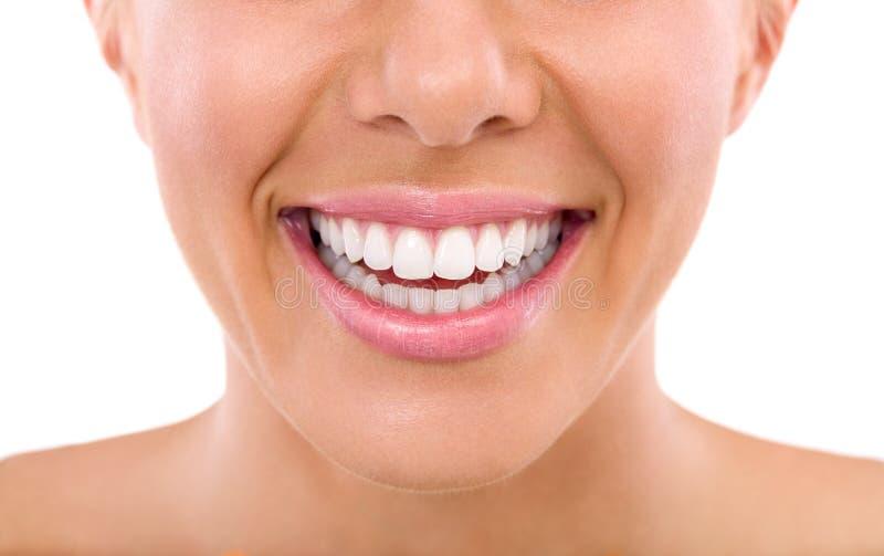 Закройте вверх зубов женщины стоковая фотография rf