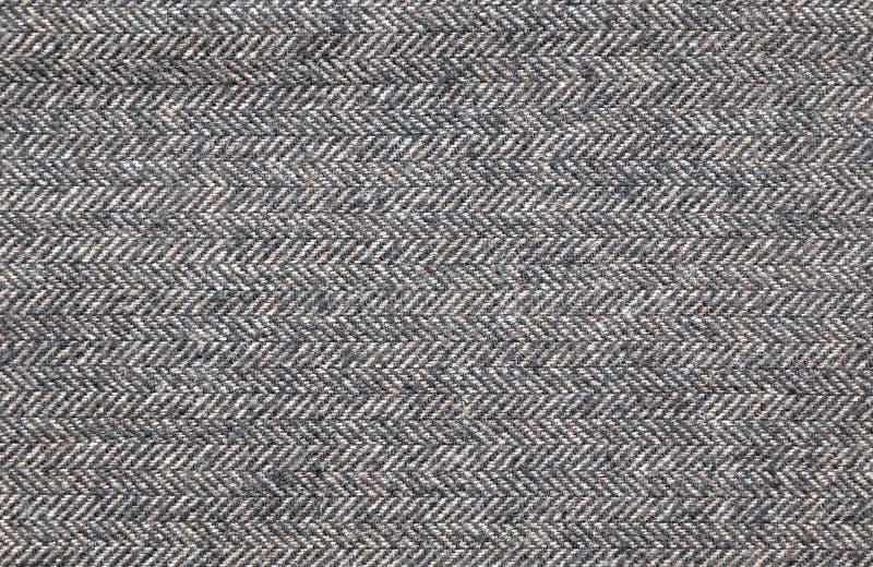 Закройте вверх коричневой ткани одежды из твида стоковые фотографии rf