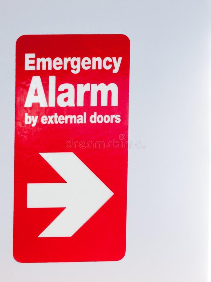 Закройте вверх красного знака с сигналом тревоги направления непредвиденным external стоковые фото