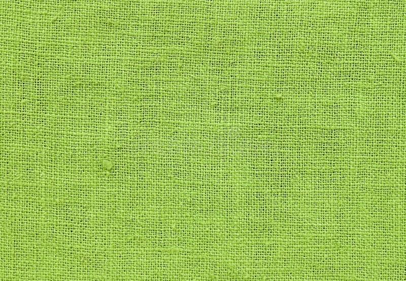 Закройте вверх по картине предпосылки зеленой Chartreuse текстуры ткани стоковые изображения
