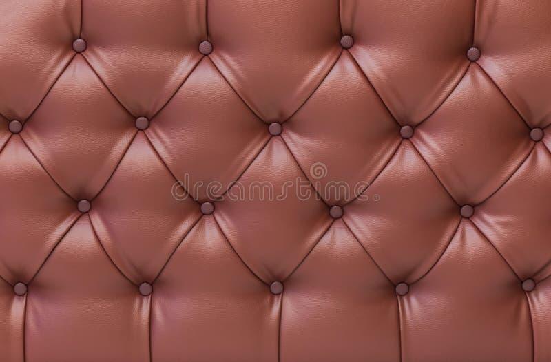 Закройте вверх по коричневой винтажной текстуре кожи софы стоковое фото