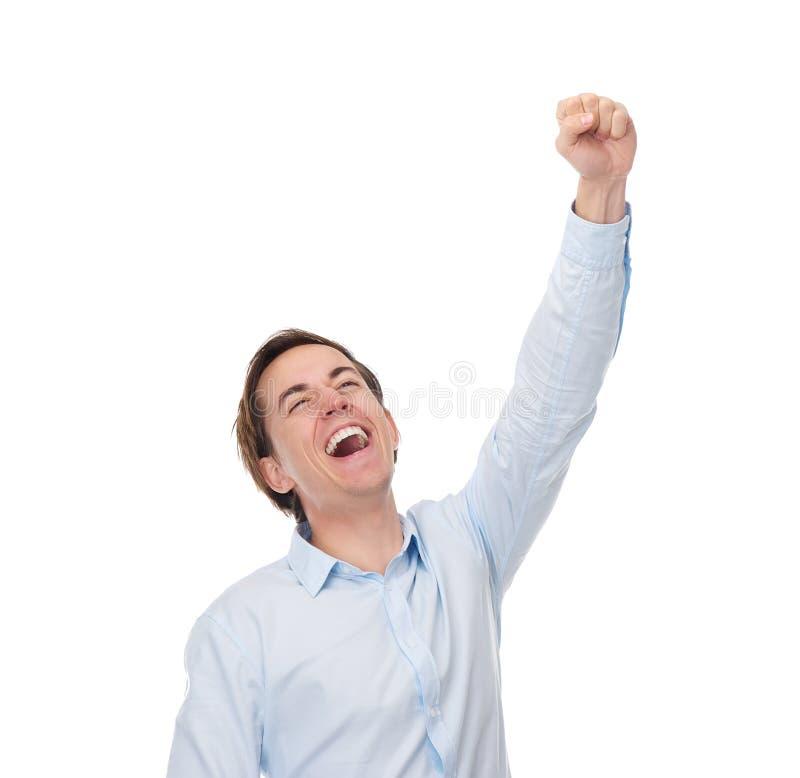 Закройте вверх по портрету счастливого человека с рукой вверх в торжестве стоковое изображение rf