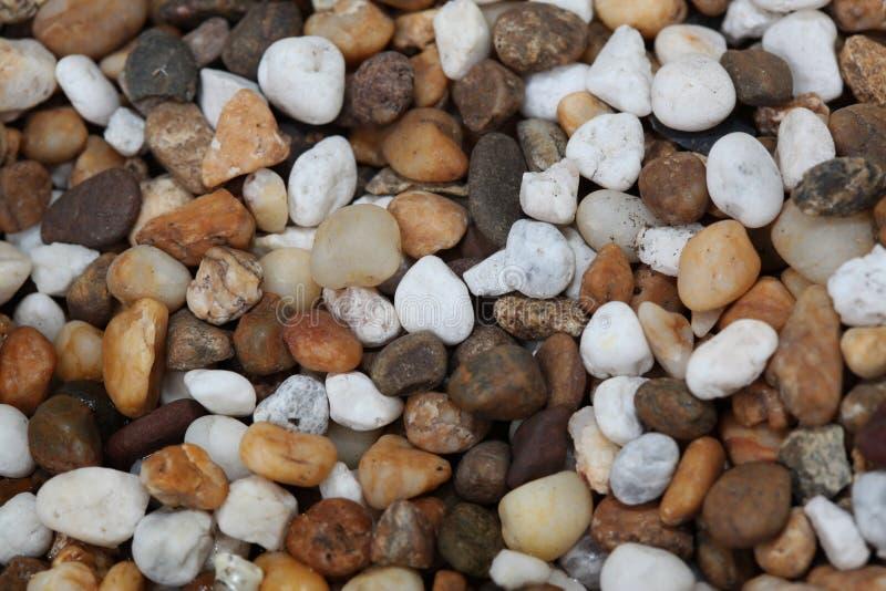 закройте вверх по предпосылкам береговых пород, камешкам текстуры стоковое фото rf