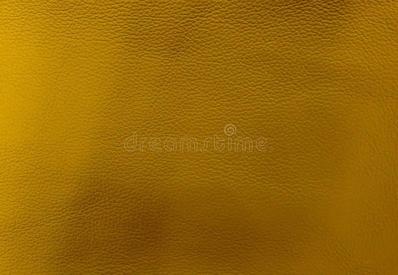 Закройте вверх по предпосылке текстуры кожи золота стоковое фото