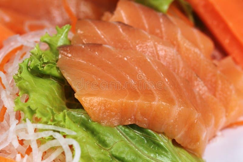 Закройте вверх по свежему Salmon сасими стоковые фото