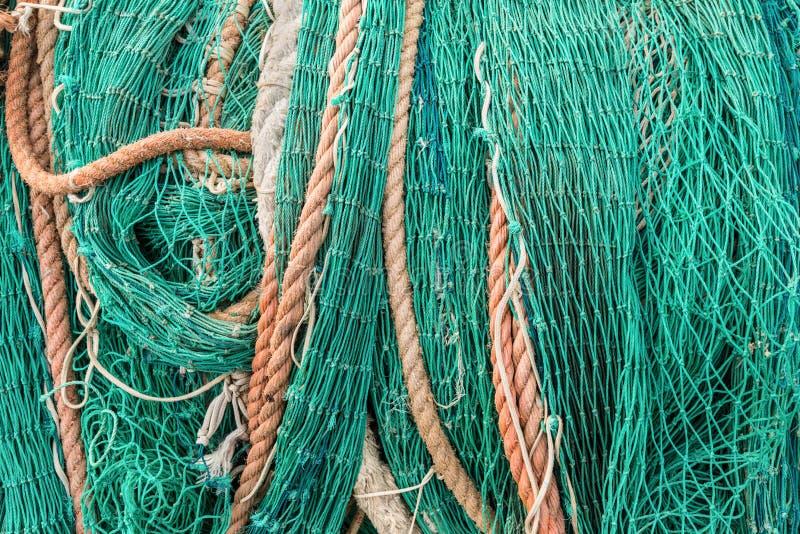 Закройте вверх по сложенное сети промышленного рыболовства стоковые изображения