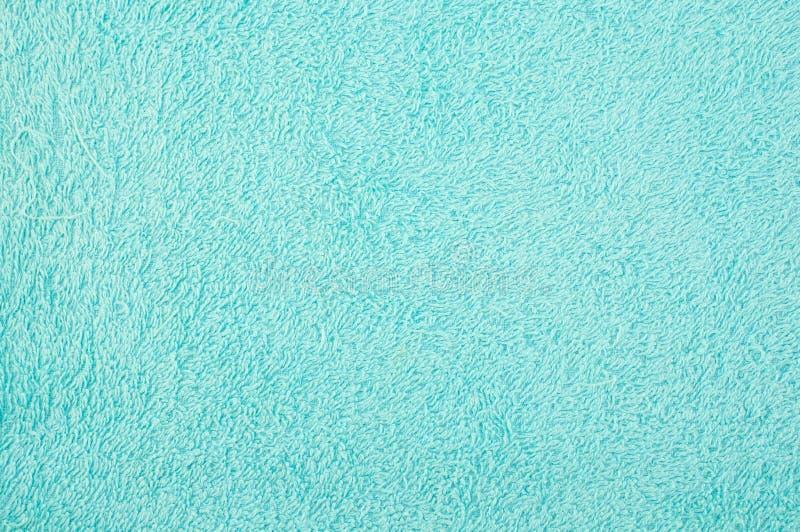 Закройте вверх по текстуре голубой пользы полотенца как предпосылка стоковые фотографии rf