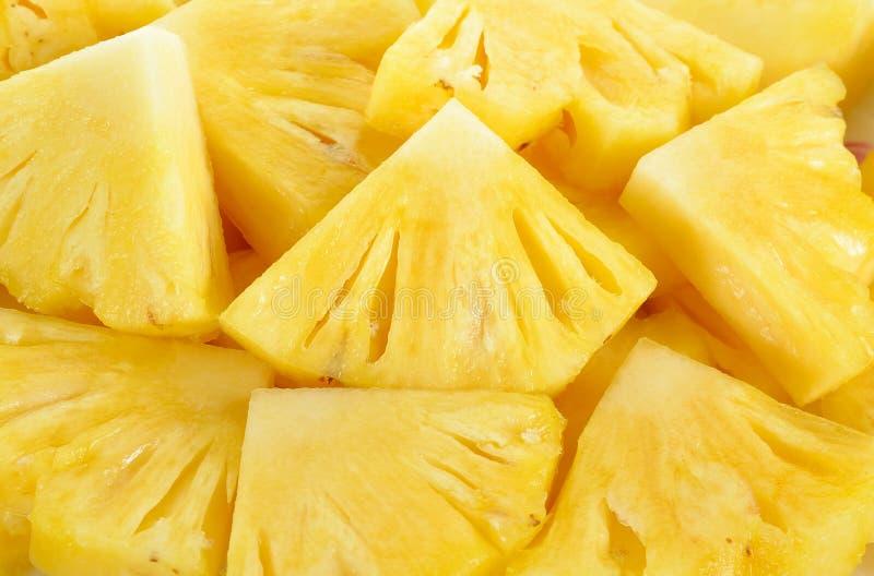 Закройте вверх по текстуре предпосылки ананаса куска стоковые изображения rf
