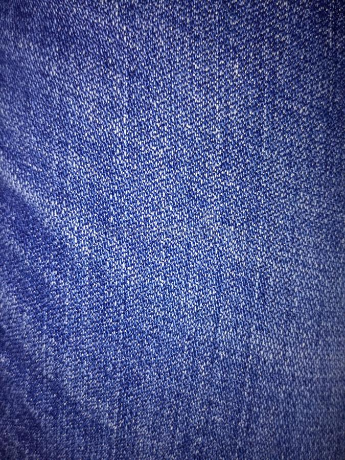 Закройте вверх по ткани джинсовой ткани структуры ткани джинсов стоковая фотография