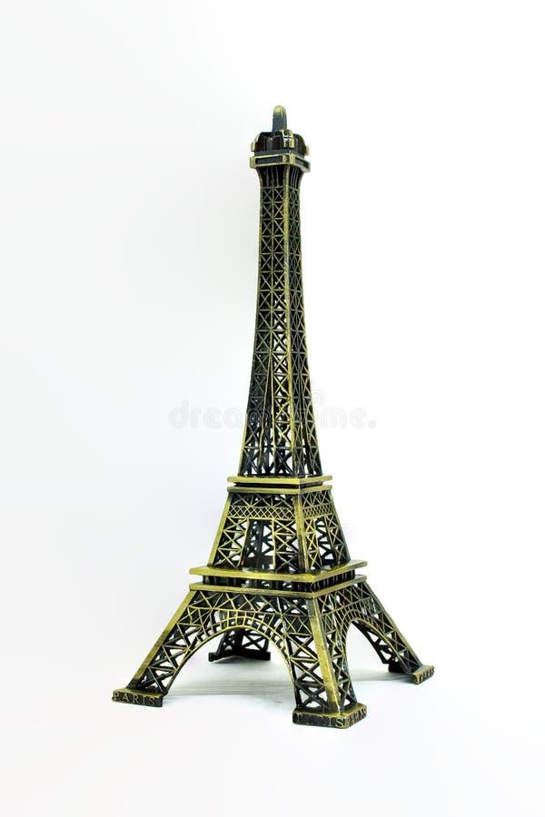 Закройте вверх по части архитектуры модели Эйфелевой башни изолированной на белой предпосылке стоковые фотографии rf