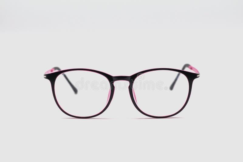 Закройте вверх по черным и розовым стеклам глаза на белой предпосылке стоковая фотография rf