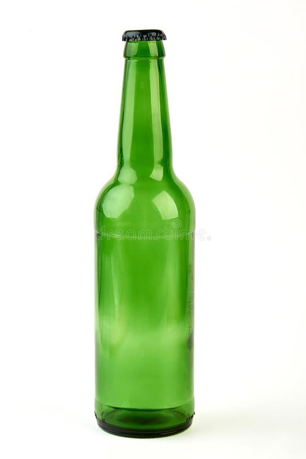Закройте вверх пустой стеклянной бутылки стоковая фотография