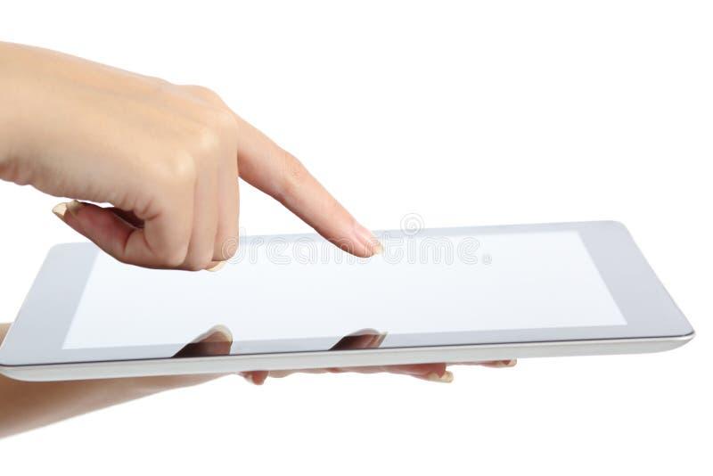 Закройте вверх руки женщины касаясь ПК таблетки стоковые изображения rf