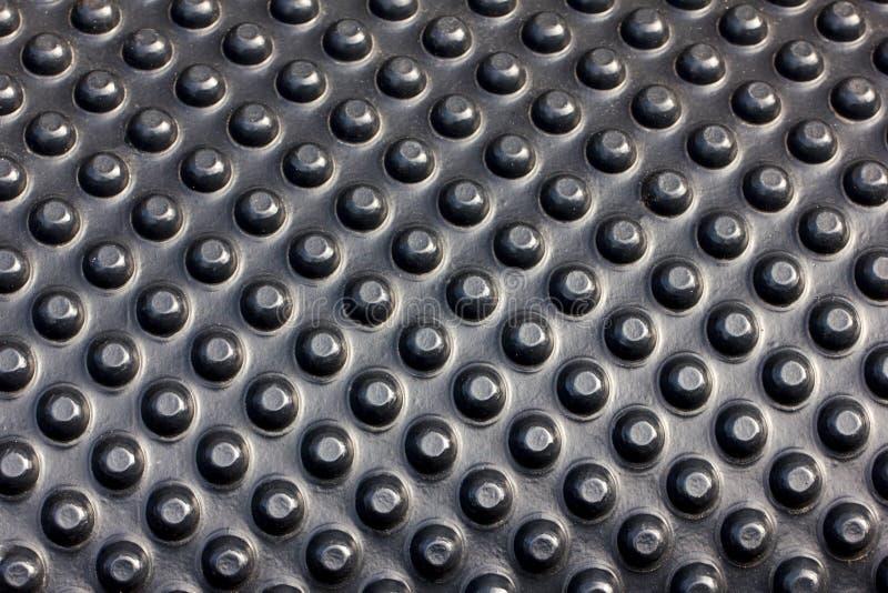 Закройте вверх циновки автомобиля - черного ковра, предпосылки половиков синтетических тканей стоковые фото