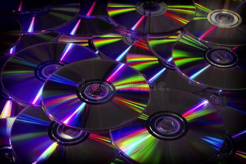 Закройте вверх DVD и КОМПАКТНОГО ДИСКА стоковая фотография rf