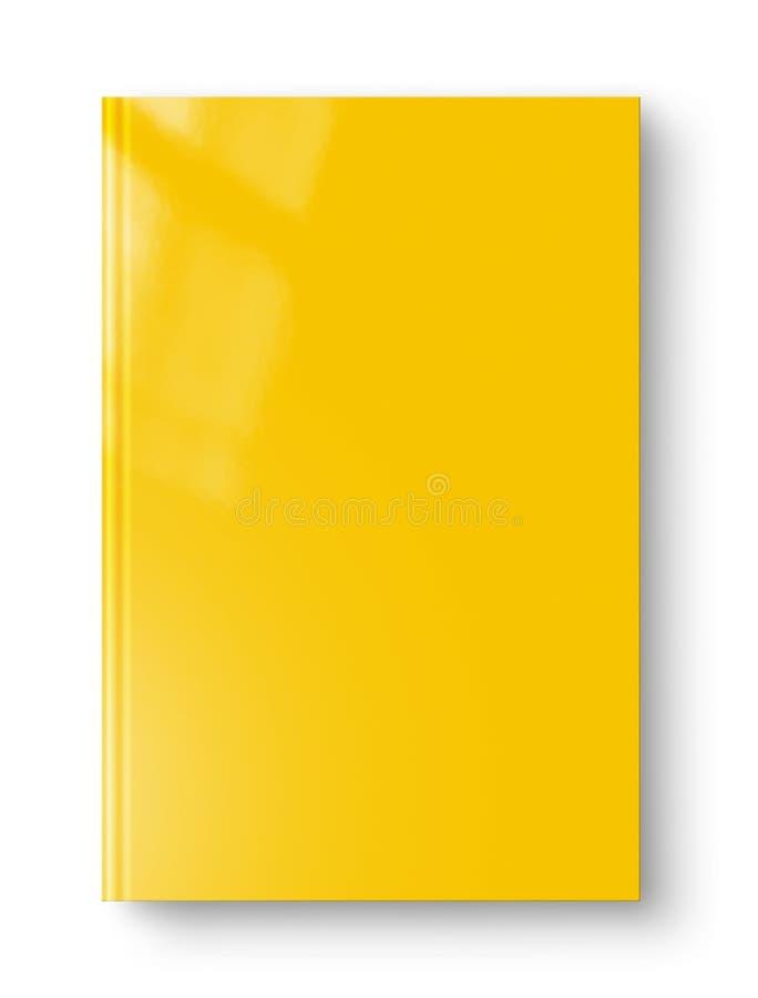 Закрытая желтая пустая книга изолированная на белизне стоковая фотография