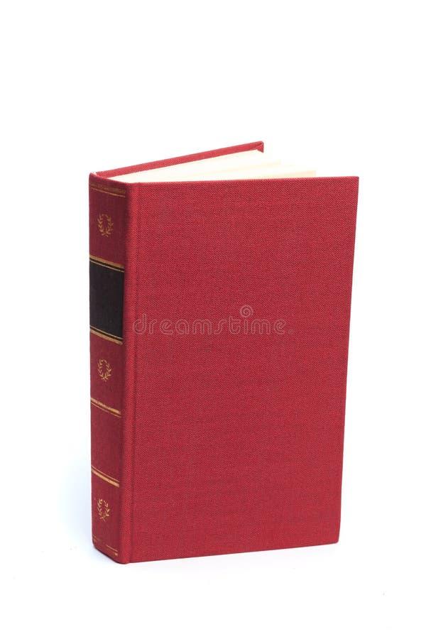 Закрытая Красная книга изолированная на белой предпосылке стоковое фото