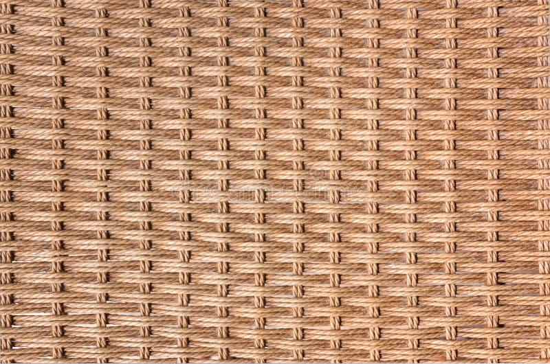 Закрытый вверх предпосылки текстуры weave коричневого цвета деревянной стоковые фото