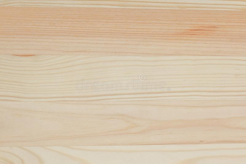 Закрытый вверх текстуры Gloden Брайна деревянной предпосылки стоковая фотография