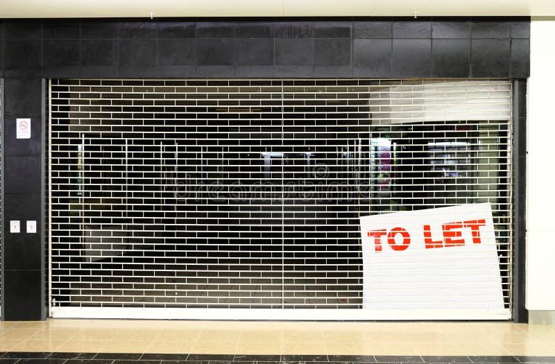 Закрытый космос дела магазина с для того чтобы позволить знаку стоковое изображение rf
