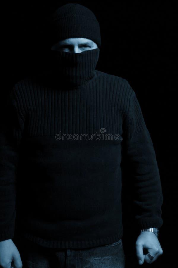замаскированный атакующий стоковое изображение rf