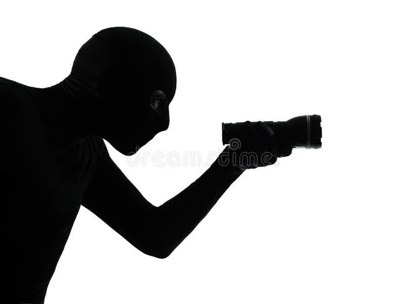 Замаскированный силуэт портрета взломщика похитителя уголовный стоковые изображения rf