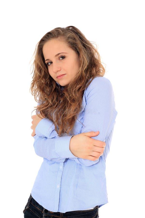 Замерзая девочка-подросток стоковое фото