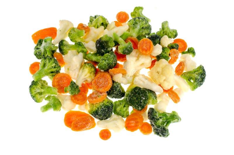 Замерли брокколи, цветная капуста, моркови на белой предпосылке стоковая фотография rf