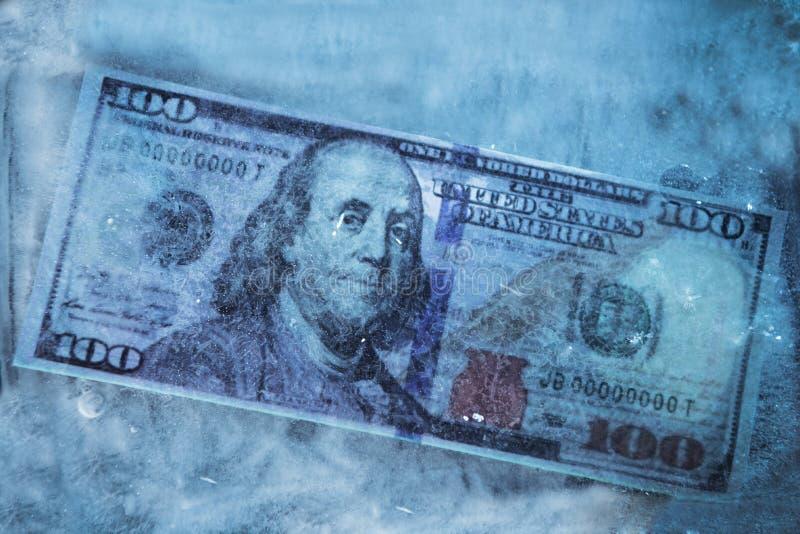 Замерли доллар, который стоковые фото