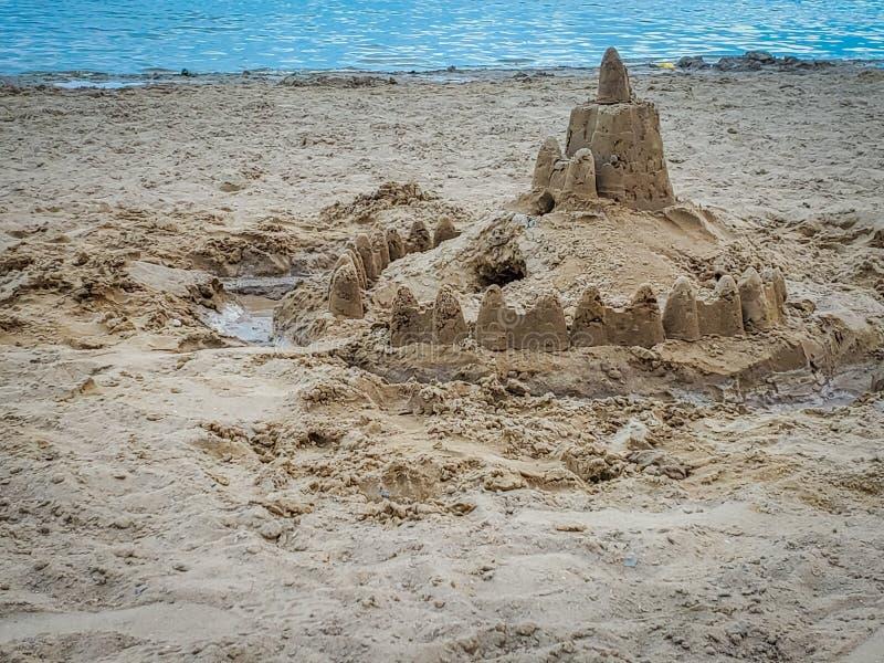 Замок песка на пляже стоковые фото