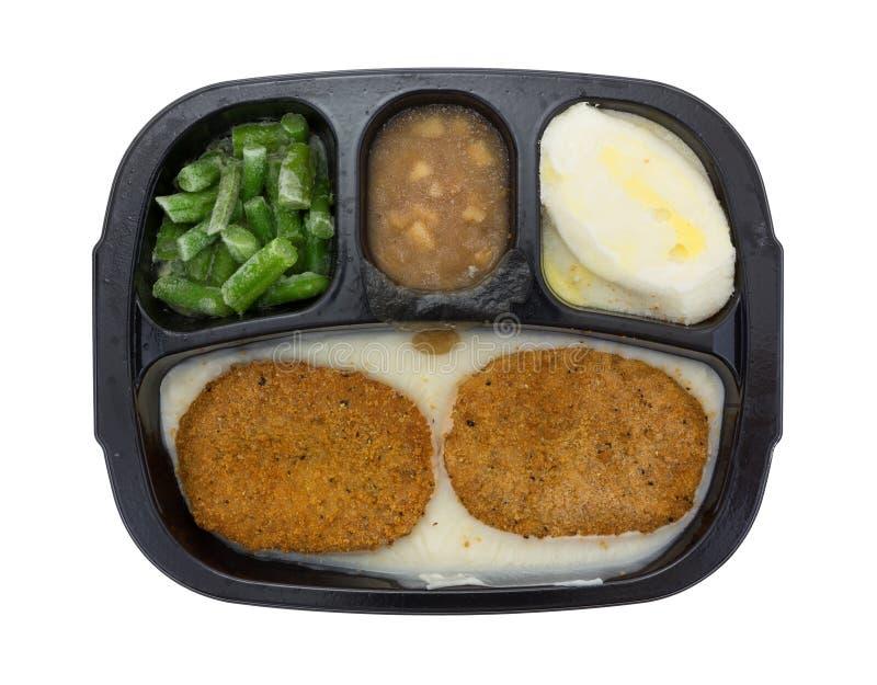 Замороженный обедающий ТВ пирожков жареной курицы на белой предпосылке стоковое изображение