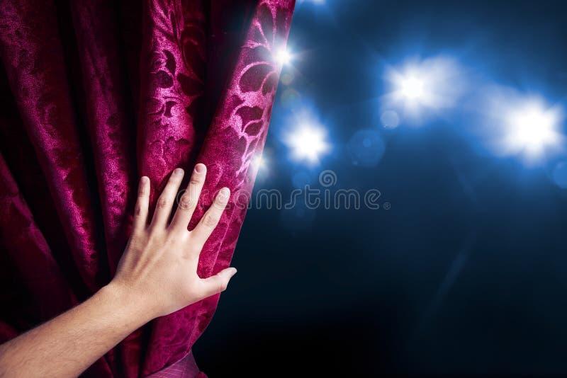 Занавес театра с драматическим освещением стоковое фото rf