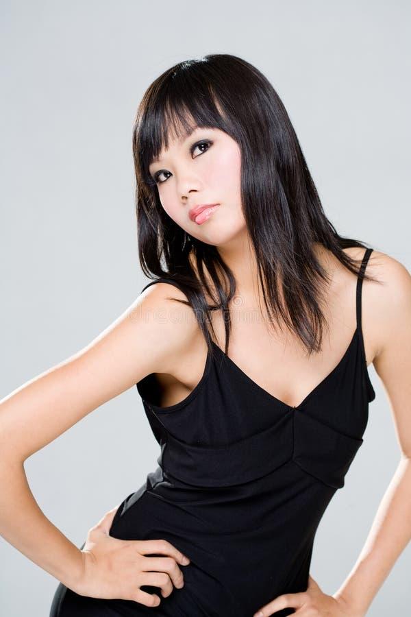 заносчивая азиатская женщина взгляда стоковое фото rf