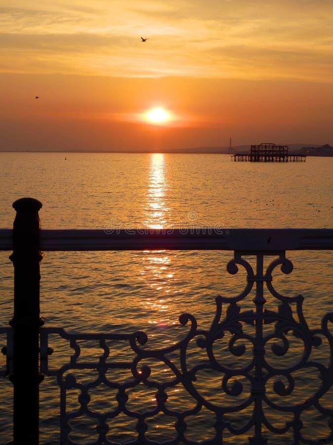 Западный заход солнца пристани стоковые изображения rf