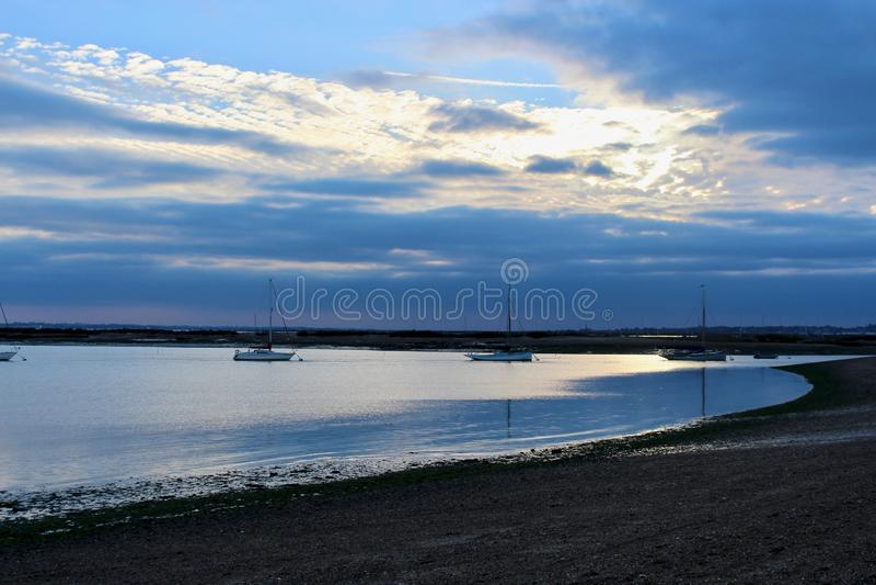 Западный пляж Mersea на сумраке стоковое изображение